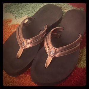 Reef Cushion flip flops in bronze